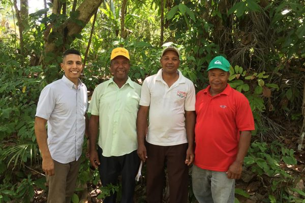 Dominican farmers and Peace Corps volunteer